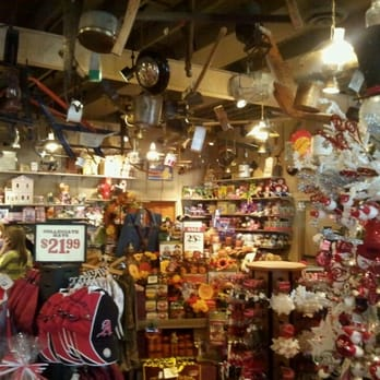 Photos of the gift shop and retail merchandise at Cracker Barrel, including rocking chairs, crosley electronics, candles, pancake mix, and more.