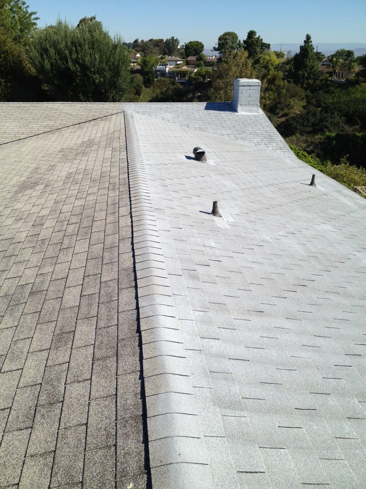 Yes you can preserve your old asphalt shingle roof by for T g roofing