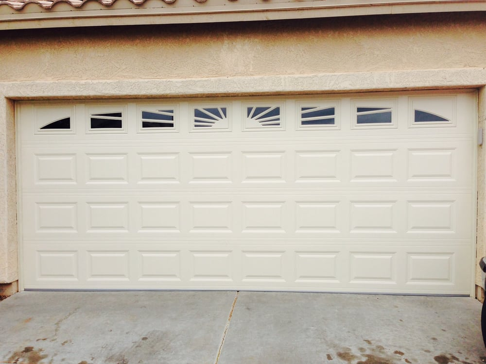 Short panel garage door with a sunburst window pattern yelp for Door pros