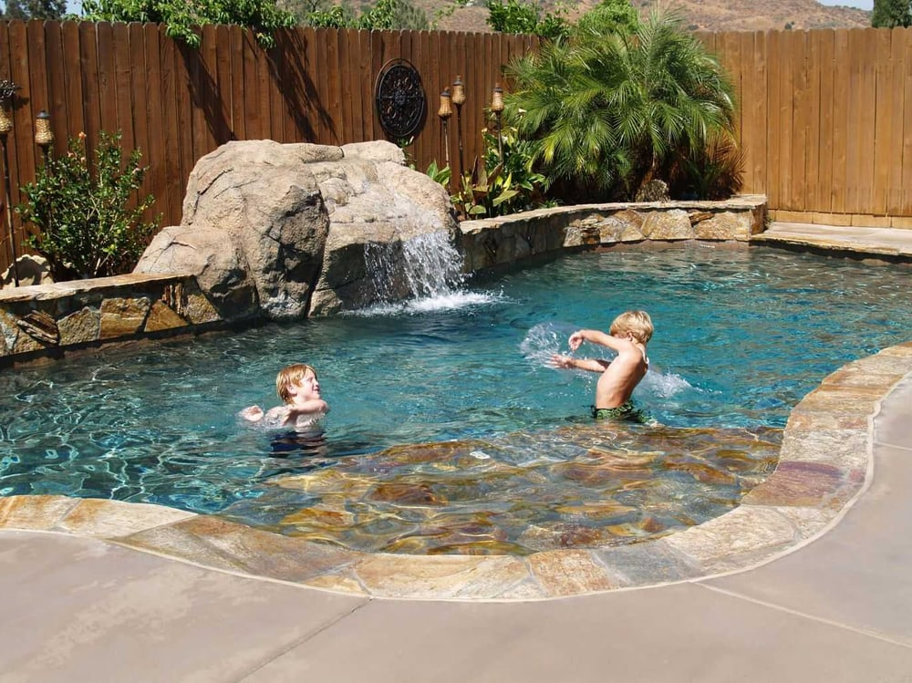 Small Play Pool With Custom Diving Waterfall And Quartzite