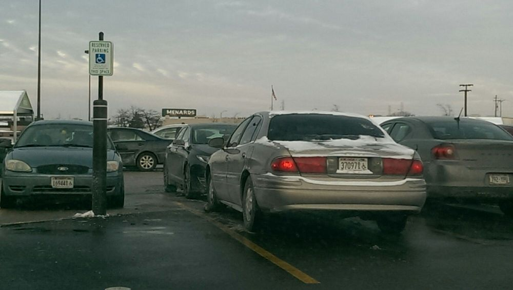 2 cars, two spots open, one spot is handicapped and one is anyone's