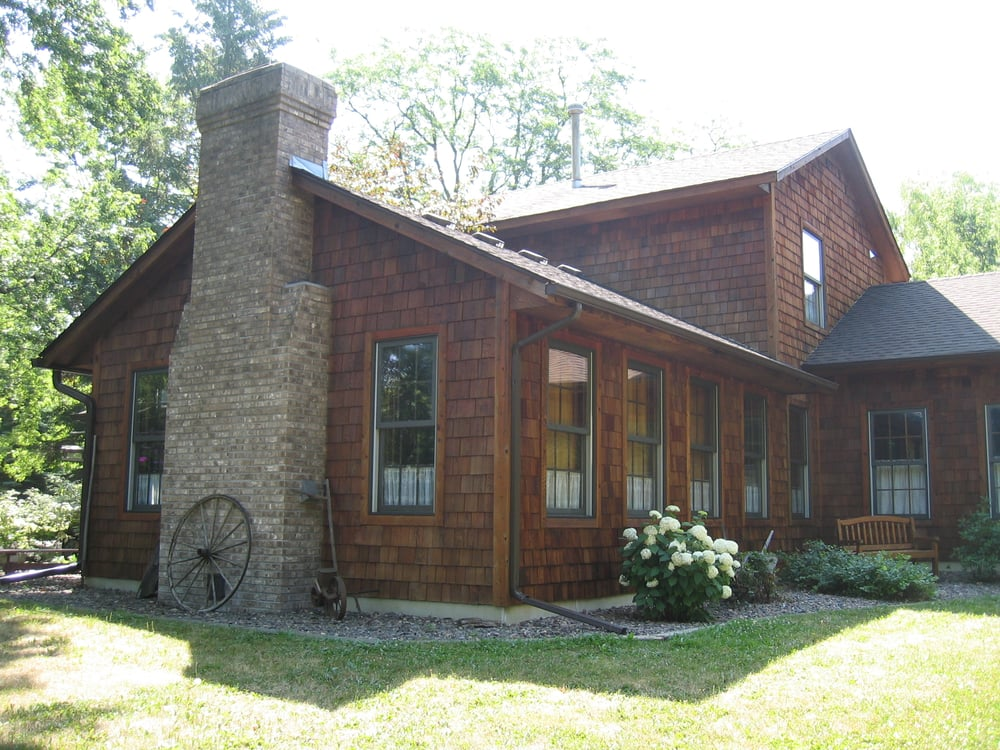 Cedar Siding Cleaning And Staining Preserves Your Siding