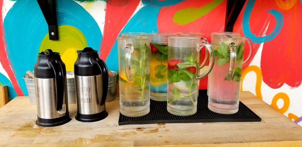 Coffee Creamers And Assorted Fruit Mint Infused Water At The Self