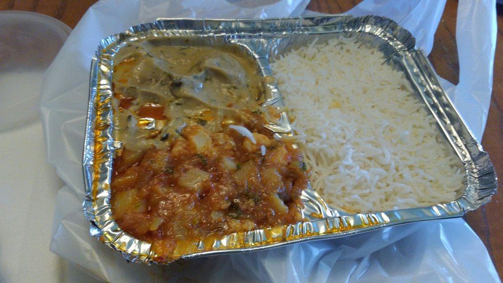 Malai Kofta Curry On Top Aloo Ghobi Curry On Bottom