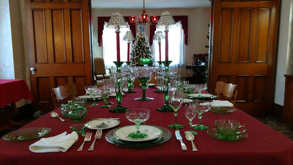 Photo of National Heisey Glass Museum - Newark OH United States. The King & The King House dining table set for a Christmas dinner. Table ...
