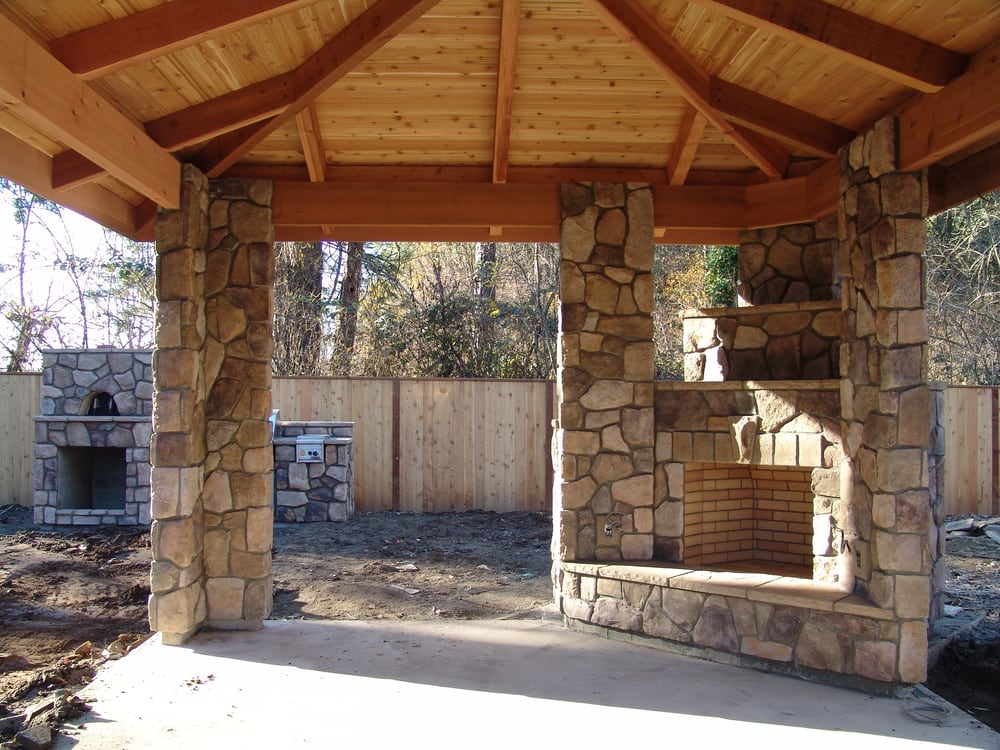 Outdoor fireplace outdoor living column stone veneer for Covered porch with fireplace
