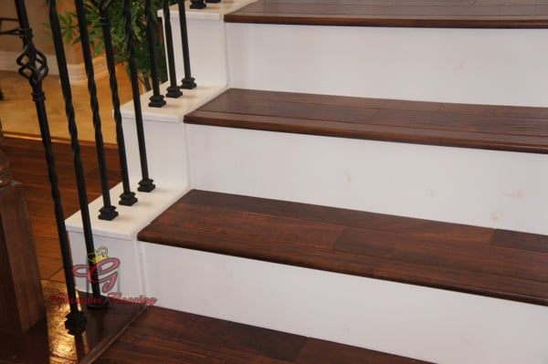 White Painted Stair Riser Installed With Acacia Hardwood