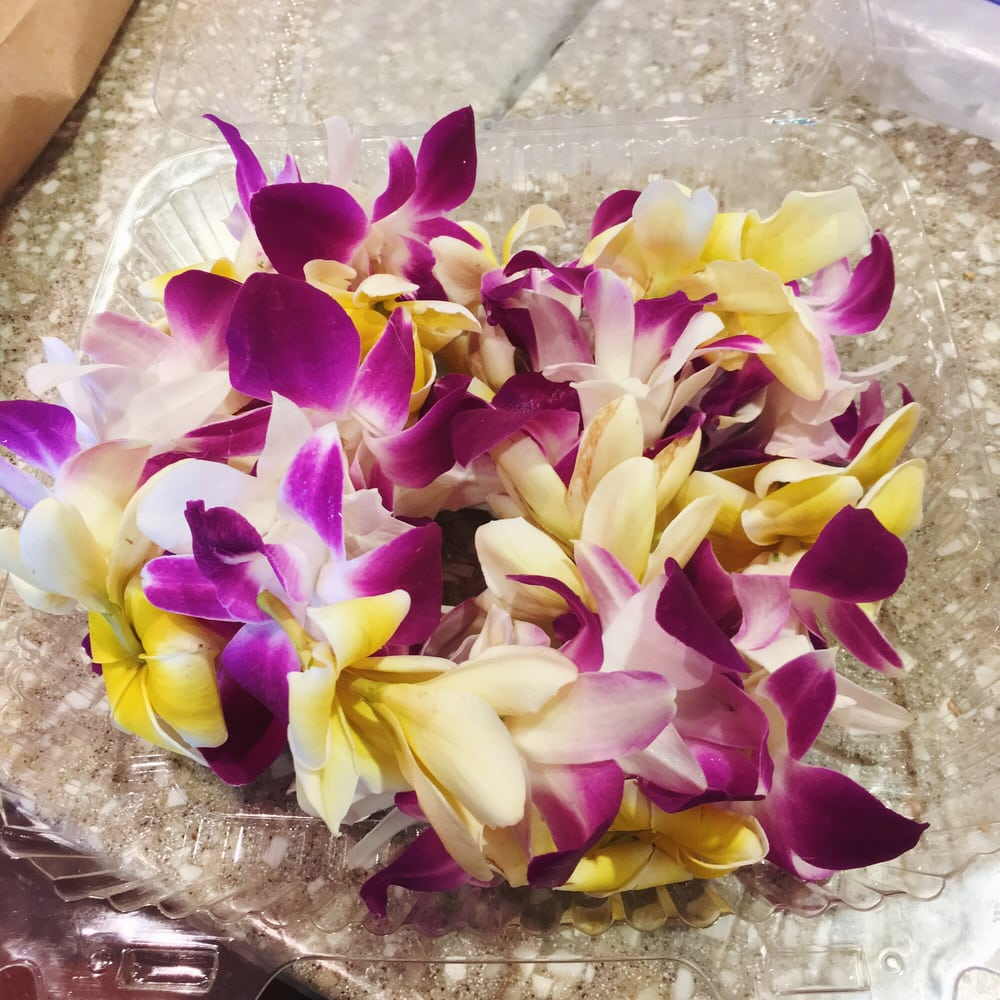 Fresh plumeria and orchid lei other varieties available at the back photo of hawaii general store gallery seattle wa united states fresh izmirmasajfo