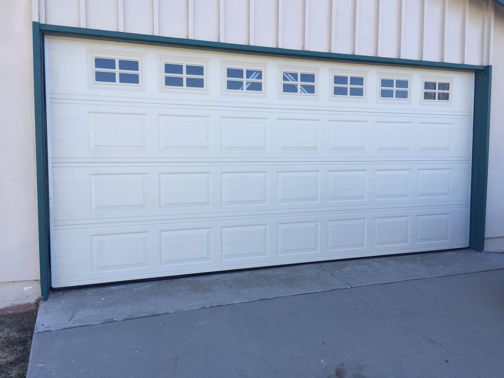 Supply and install new one piece door in westminster ca yelp for Local garage door