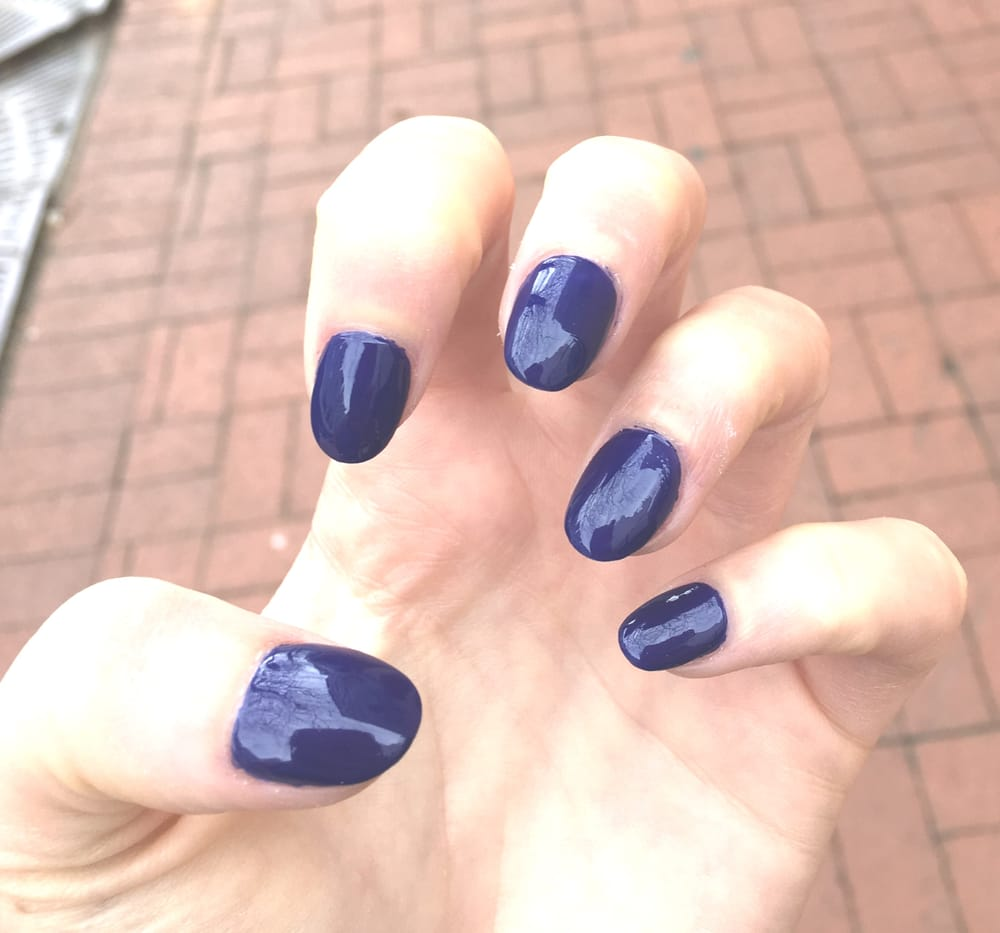 Acrylic oval shaped nails with navy blue regular polish for $20 - Yelp