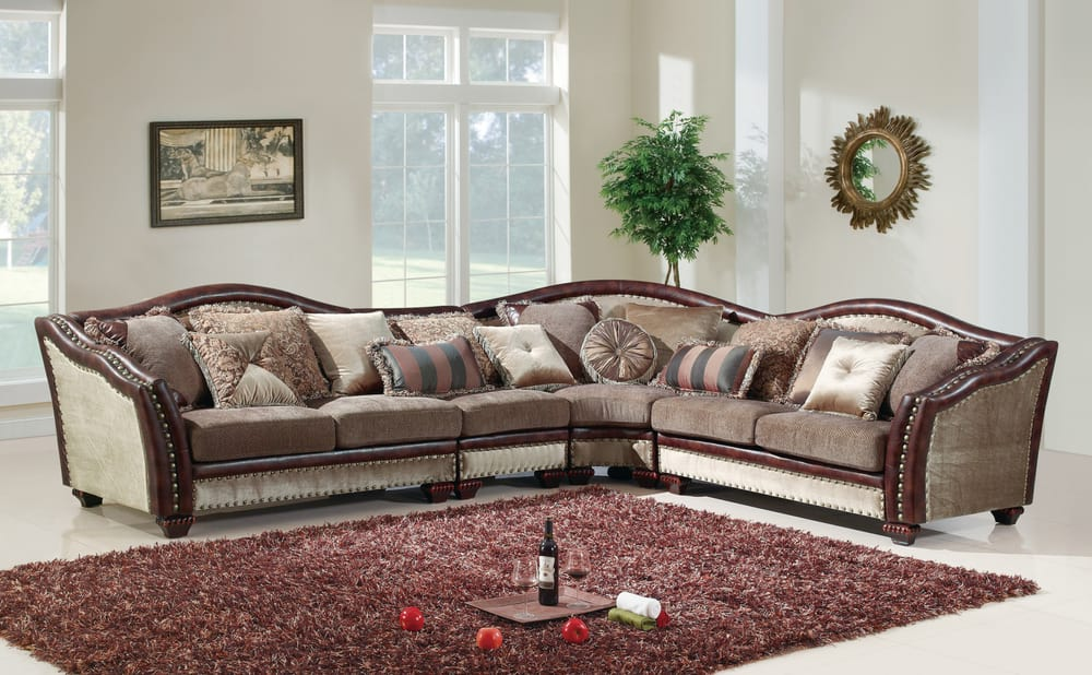 Beautiful formal sectional features nail head accents and for Furniture emporium