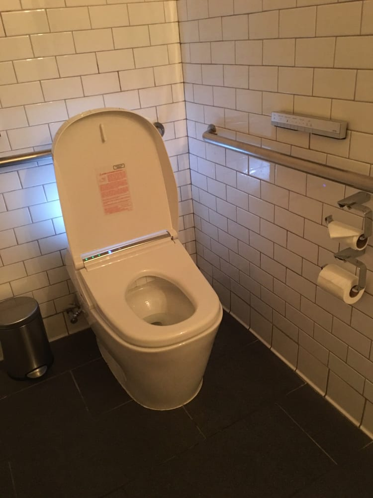 Awesome toto toilet. The toilet seat is heated and the lid ...
