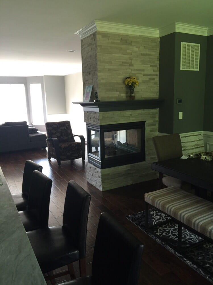 Ledger Stone Fireplace And Handscraped Hardwood Flooring