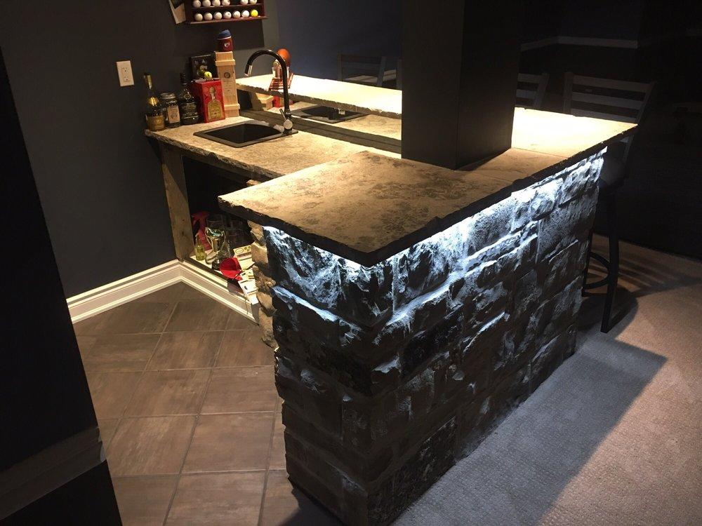 Custom Natural Stone Bar With Mirror Backsplash And Led