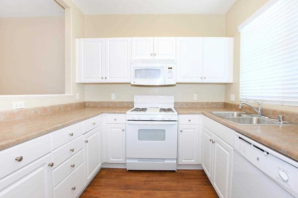 Contemporary white kitchen and bathroom cabinets yelp for Bathroom cabinets yelp