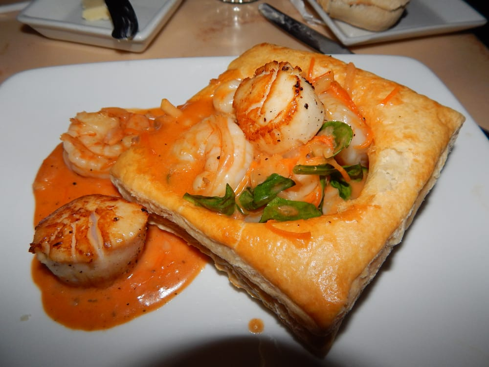 Sautéed Shrimp and Scallops with Seasonal Vegetables and Mushrooms served in Puff Pastry with a ...
