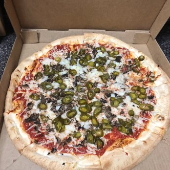 Photo of Tomasino's Pizza - Orlando, FL, United States. 18 inch vegan pizza with mushrooms, onions and jalepenos.