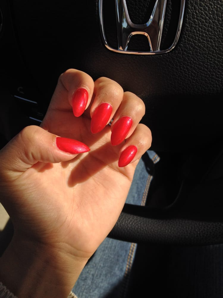 Pointy nails color is pearl red i love them thanks tu for A touch of elegance salon