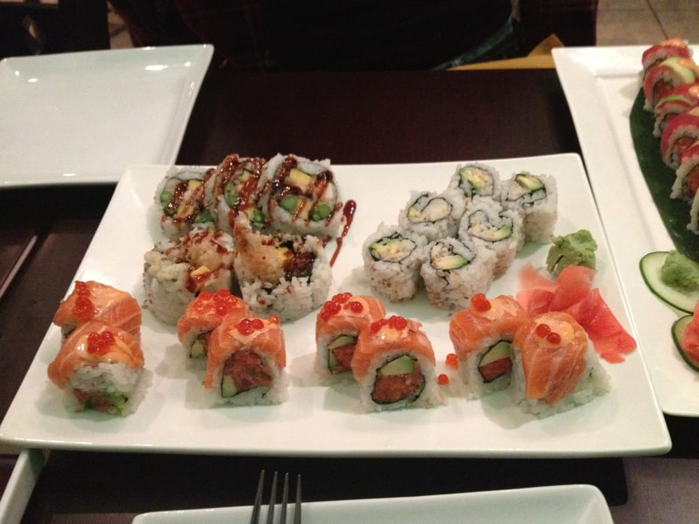 house tempura king crab avocado and salmon tuna rollover
