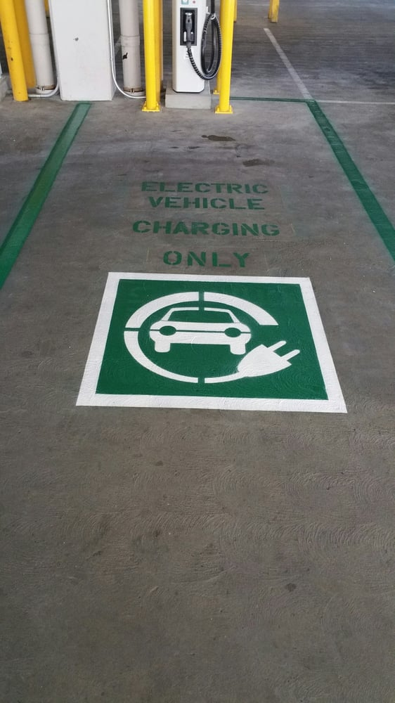 New layout and striping of the new electric vehicle charging ...