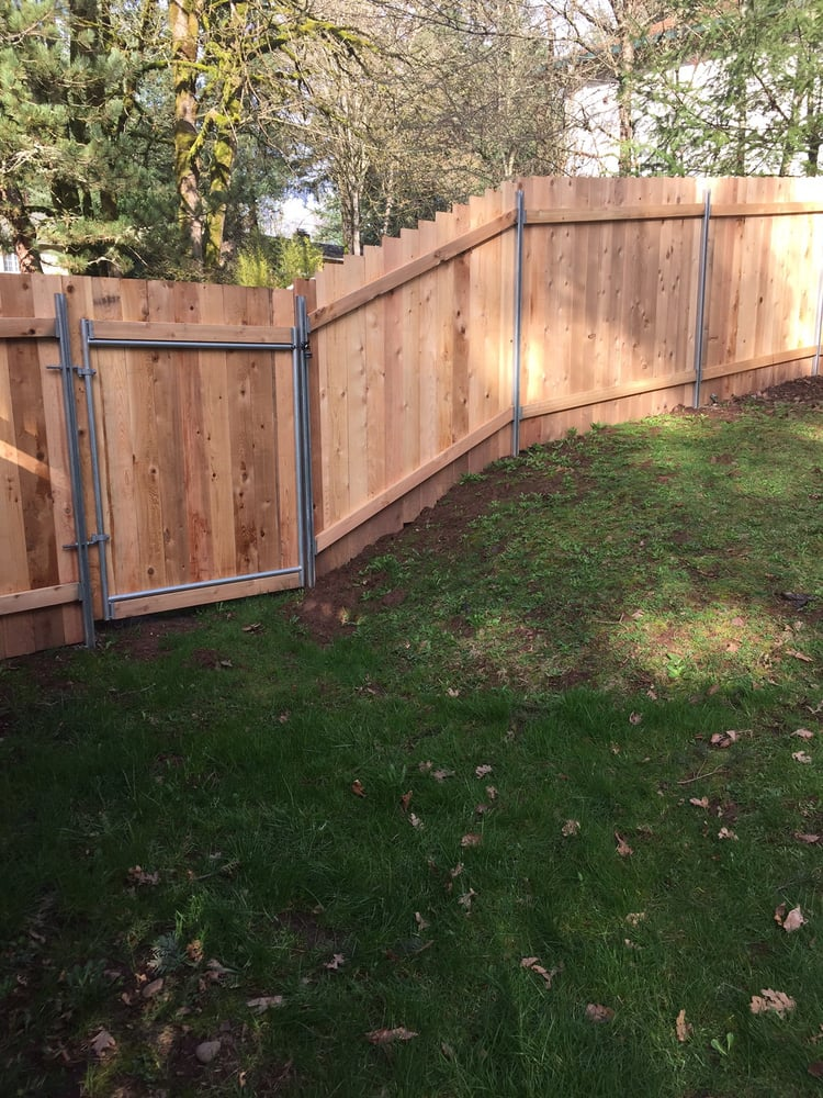 6\' cedar fence on a slight slope with galvanized steel posts - Yelp