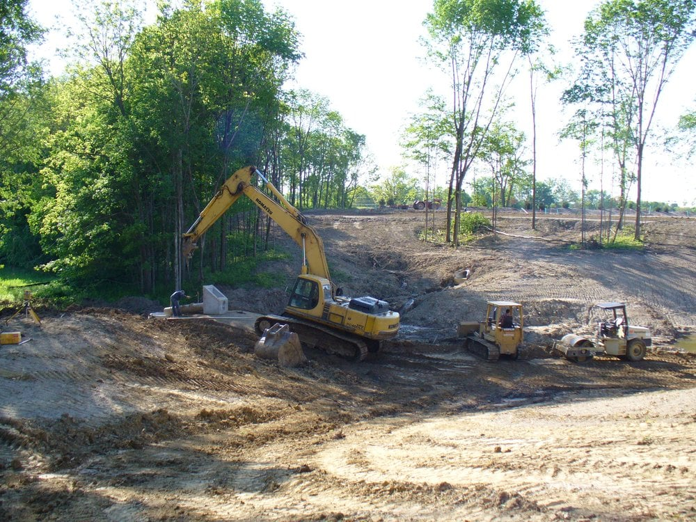 Installing spillway and overflow for pond yelp for Pond companies near me