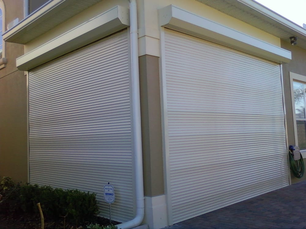 Motorized roll up shutters on a lanai opening closed yelp for Motorized roll up shades