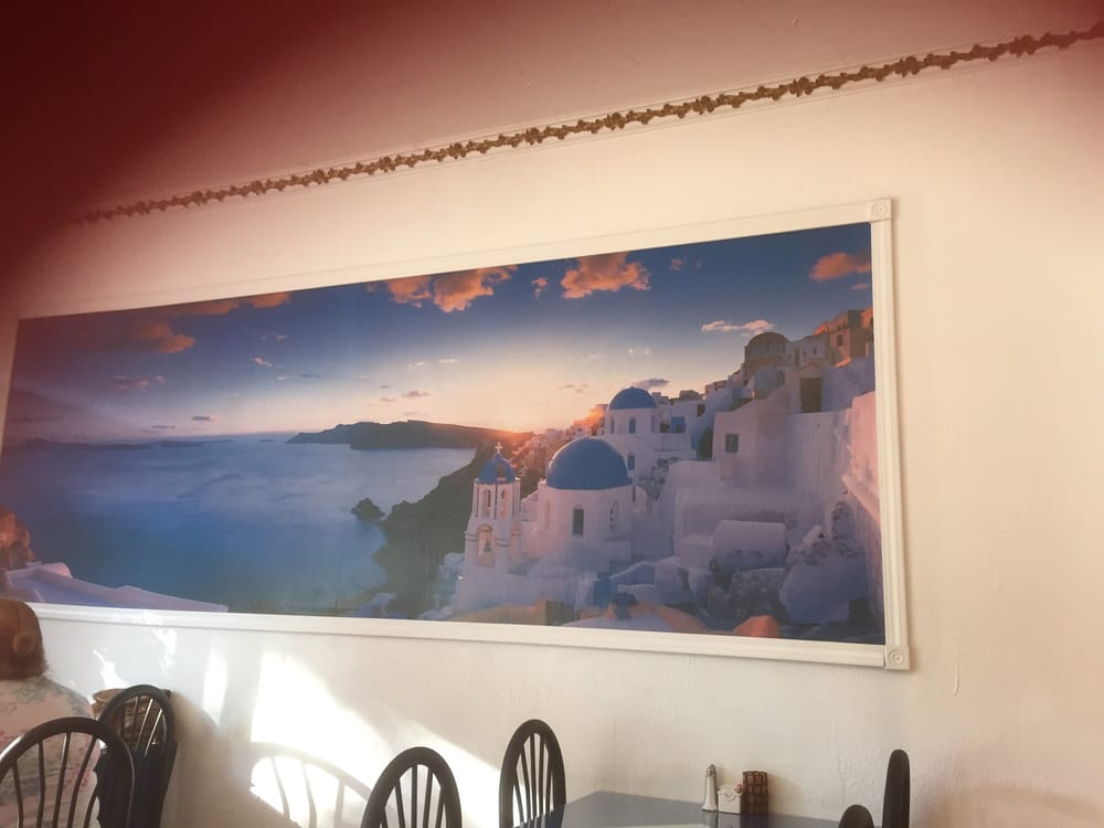Fun murals in the walls and greek postcards at the table for Alexanders greek cuisine