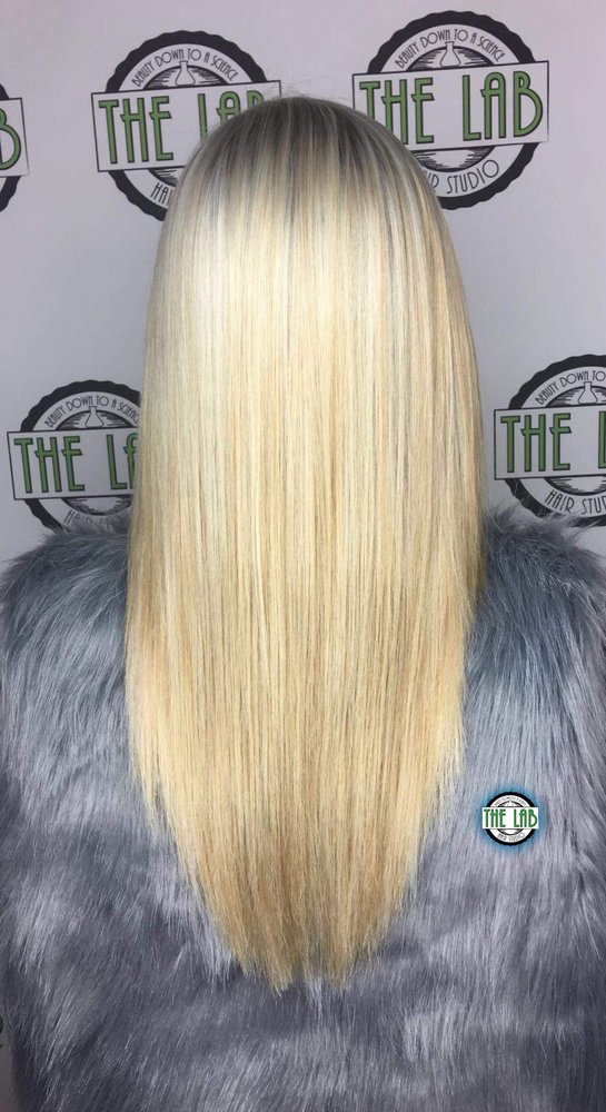 Womans Haircut With Extensions And Full Platinum Blonde Color