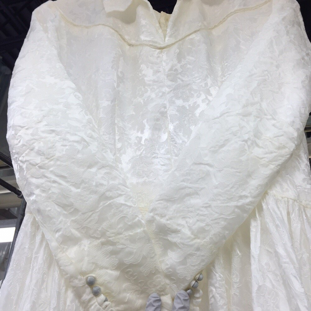 Post restoration the dress is brought back to its for Wedding dress cleaning seattle
