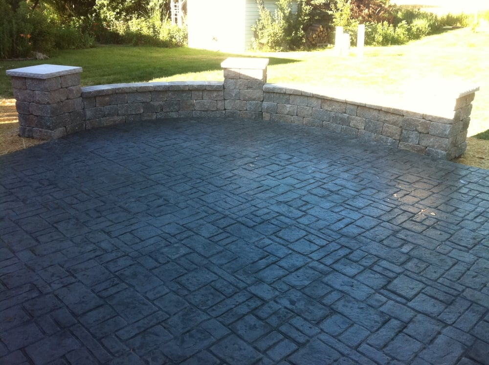 Stamped concrete patio with block seat wall with pillars - Exterior house washing madison wi ...
