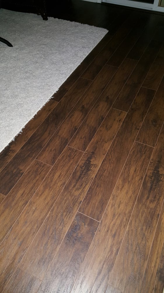 Laminate flooring in living room yelp for Laminate floor covering