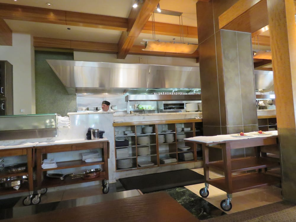 Part of the kitchen and staging area yelp for Mina s kitchen