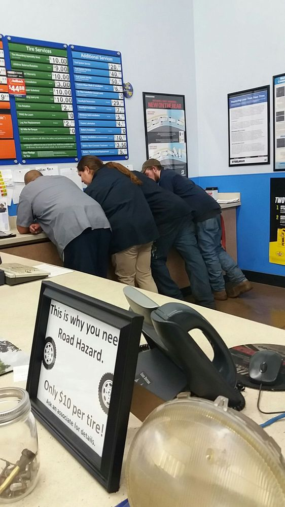 How many Wal-Mart employees does it take to change an auto