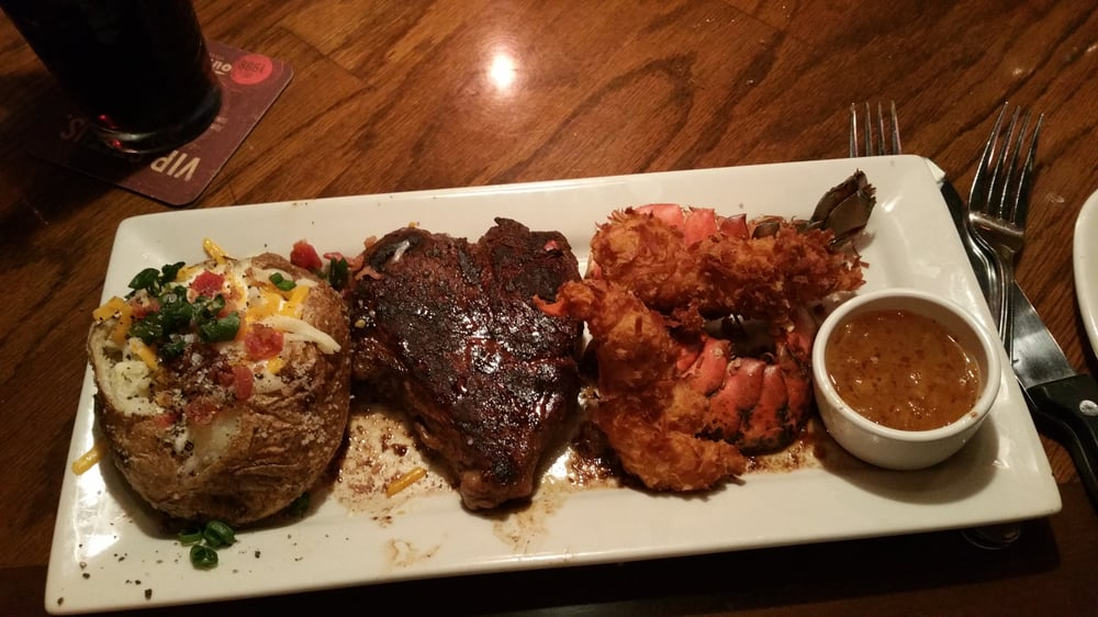 Steak and coconut lobster with a baked potato. It was excellent - Yelp