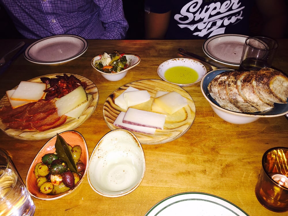Photo of Bar Isabel - Toronto ON Canada. Mixed meat plate olives & Mixed meat plate olives cheese plate sourdough bread - Yelp