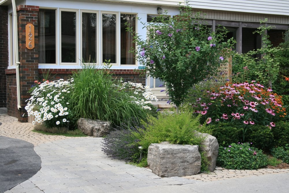 Front yard entrance curb appeal planting interlocking for Simple front landscape ideas