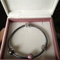 Photo of Pandora Concept Store at Kingsway Mall - Edmonton, AB, Canada. Oxidized Sterling Silver Bracelet with two clips and one charm.