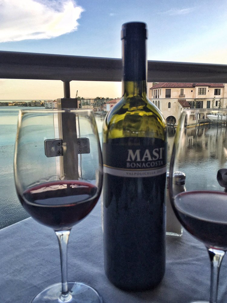 Photo of Bayside Seafood Grill & Bar - Naples, FL, United States. Italian red with the view