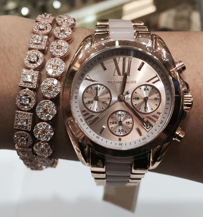 8bd91255a6465 One of our many Michael Kors watches in rose gold color with some ...