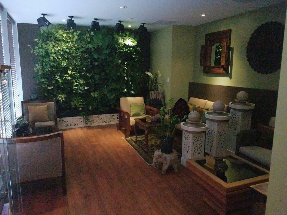 a post massage lobby with fountains and live plants is a. Black Bedroom Furniture Sets. Home Design Ideas