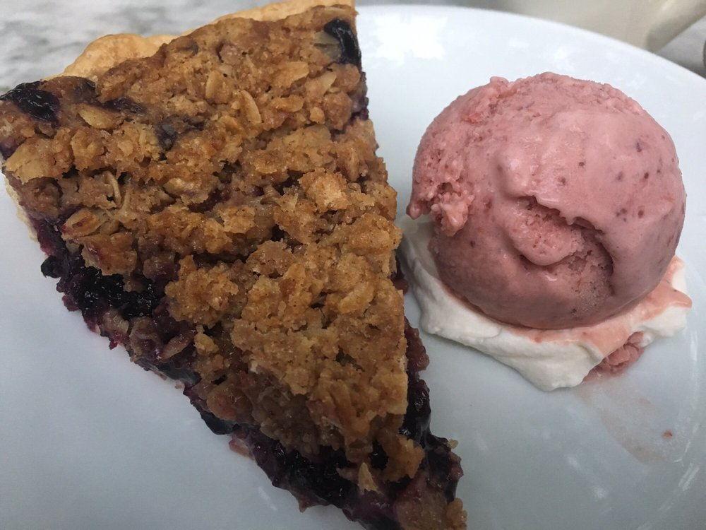 Blueberry pie with crumble topping and strawberry ice cream