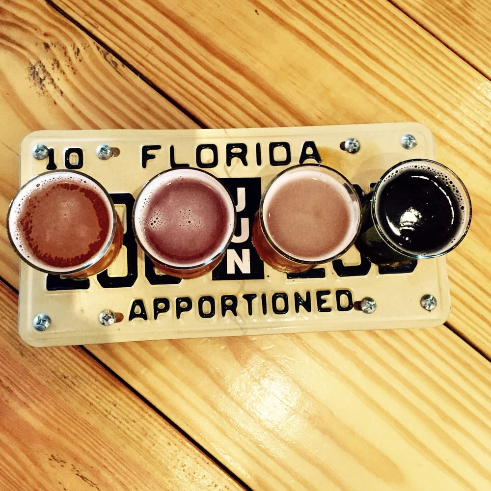 beer flight served up on a florida license plate cool touch yelp