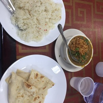 Photo of Haat Bazaar - Jackson Heights, NY, United States. Pulao rice, naan and Halim (a must try flavorful stew)