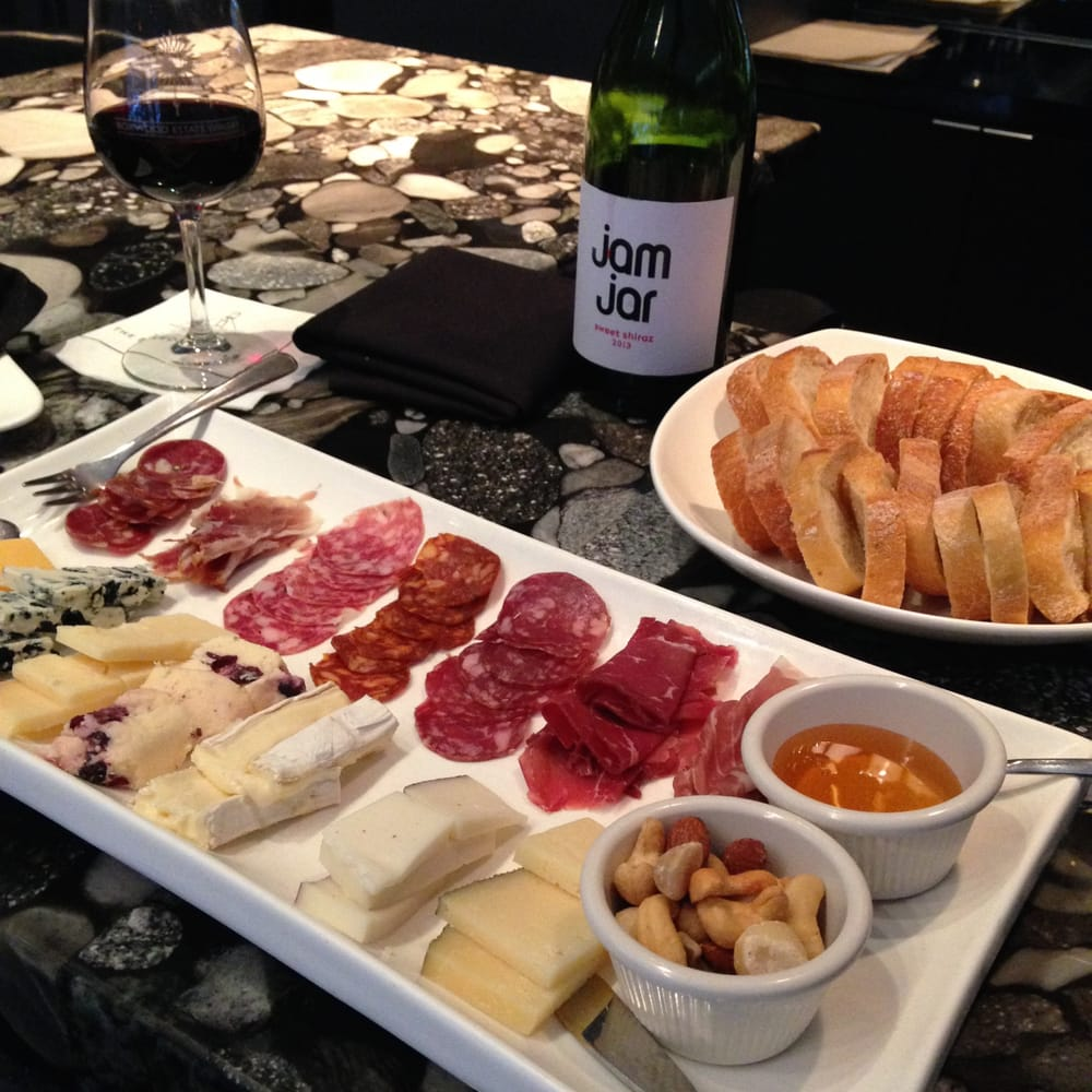 International Cheese And Charcuterie Plate With A Bottle