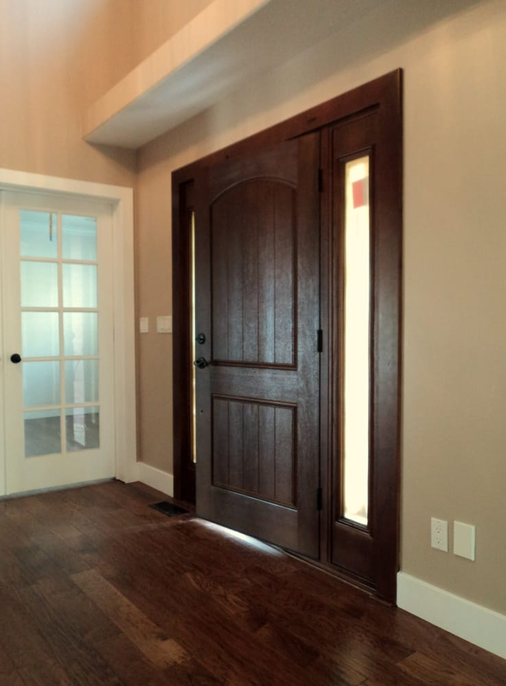 Dark Stain On The Front Door Painted Walls And Trim In The