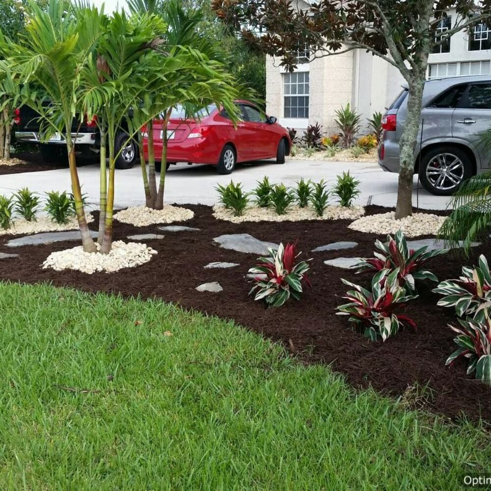 Tropical landscape design and install palms ti 39 s croton for Installing river rock landscaping