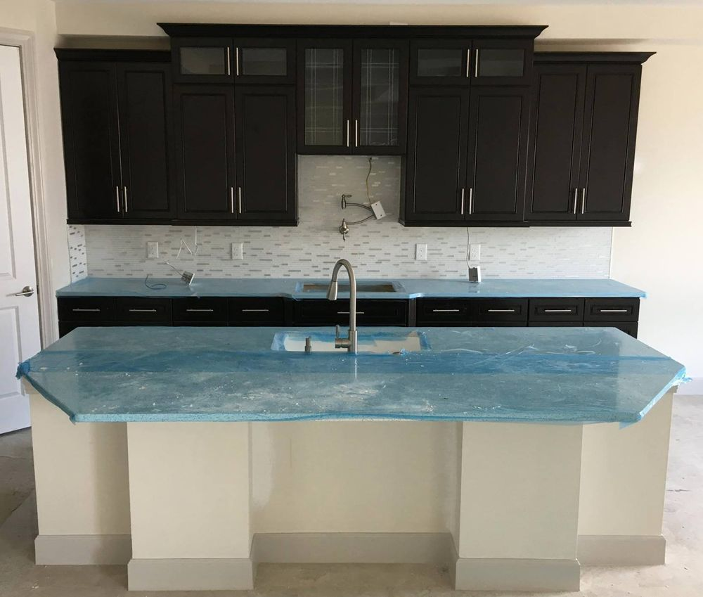 Finished product of our K8 Espresso Cabinets by a lake side home in ...