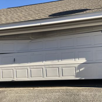 Garage guru 18 reviews garage door services 431 for Garage door repair austin yelp