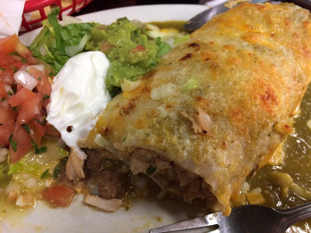Super burrito chicken with added green wet sauce - Mexican american cuisine ...